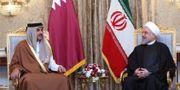 Qatars emir Tamim bin Hamad Al Than och  Irans president Hassan Rouhani. - / Iranian Presidency
