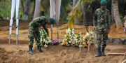 Specialstyrkor på Sri Lanka letar efter explosiva ämnen.  Gemunu Amarasinghe / TT NYHETSBYRÅN