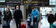 Resenärer på en flygplats i Barcelona. NACHO DOCE / TT NYHETSBYRÅN