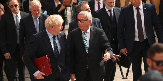 Boris Johnson och Jean-Claude Juncker. Francisco Seco / TT NYHETSBYRÅN