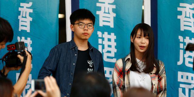 Protestledarna Joshua Wong och Agnes Chow.  THOMAS PETER / TT NYHETSBYRÅN