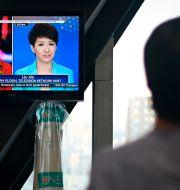 Liu Xin är nyhetsankare på kinesiska statliga nyhetsmediet CGTN.  WANG ZHAO / AFP