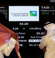 Arkivbild: En del av Saudi Aramco bjöds ut till allmänheten i samband med börsnoteringen på Tadawul 2019.  Amr Nabil / TT NYHETSBYRÅN