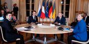 Volodymyr Zelenskyj, Emmanuel Macron, Vladimir Putin och Angela Merkel.  Ian Langsdon / TT NYHETSBYRÅN