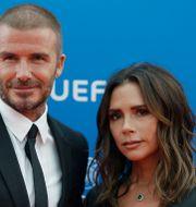 David och Victoria Beckham. Claude Paris / TT NYHETSBYRÅN