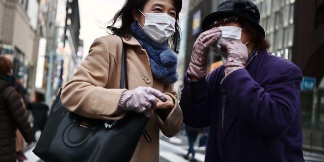 Invånare i Wuhan.  CHARLY TRIBALLEAU / AFP
