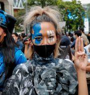 Demonstranter i Bangkok under söndagen.  Gemunu Amarasinghe / TT NYHETSBYRÅN