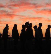 Gruvarbetare i Sydafrika.  Denis Farrell / TT / NTB Scanpix