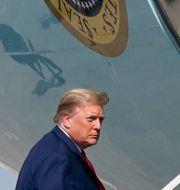 Donald Trump kliver på Air Force One den 31 december. Patrick Semansky / TT NYHETSBYRÅN