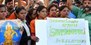 Protester i Kerala efter att kvinnor besökt templet Sabarimala.  MANJUNATH KIRAN / AFP
