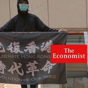 """In this June 9, 2020, file photo, protesters show a banner """"Librate Hong Kong, Revolution of out time,"""" left, and """"Hong Kong Independence"""" in a shopping mall during a protest in Hong Kong. The slogans had just been banned by the government under the new legislation, stating that it had separatist connotations. TT"""