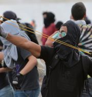 Bild från tisdagens protester i Brasilia. Eraldo Peres / TT / NTB Scanpix