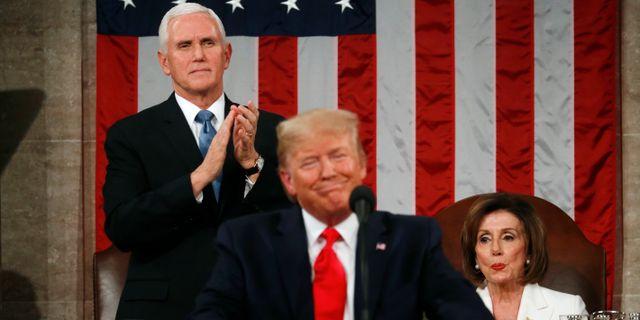 Mike Pence, Donald Trump och Nancy Pelosi. Leah Millis / TT NYHETSBYRÅN