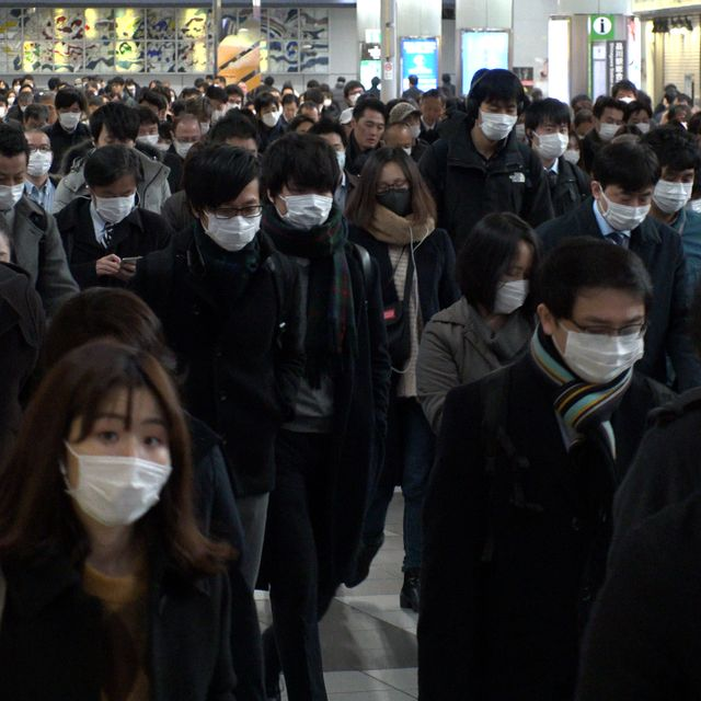TOKYO, JAPAN - MARCH 2020 : Crowd of people walking at Shinagawa station in busy morning rush hour. Many commuters going to work. People wearing surgical mask to protect from Coronavirus(COVID-19). Shutterstock