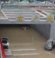 Översvämmad tunnel i Zhengzhou. TT NYHETSBYRÅN