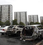 Utbrända bilar efter händelsen Adam Ihse/TT / TT NYHETSBYRÅN