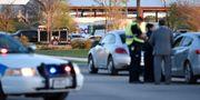 Polis utanför FedEx-kontoret i Schertz nära San Antonio i morse. SERGIO FLORES / TT NYHETSBYRÅN