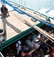 Iranska asylsökande stoppas i Indonesien på väg till Australien 2013. Firdia Lisnawati / TT / NTB Scanpix