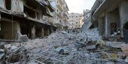 En gata i syriska Ariha efter ett bombangrepp. Ghaith Alsayed / TT NYHETSBYRÅN