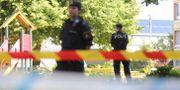 Polis i Gårdsten i samband med händelsen. Adam Ihse/TT / TT NYHETSBYRÅN