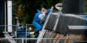 Nautilus undersöks av en av polisens tekniker. Liselotte Sabroe / TT NYHETSBYR N