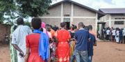 Kö till vallokal i Ngozi. STR / AFP