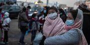Migranter på ön Lesbos i Grekland. LOUISA GOULIAMAKI / TT NYHETSBYRÅN