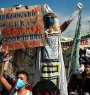 Protester mot Bolsonaro. Bruna Prado / TT NYHETSBYRÅN