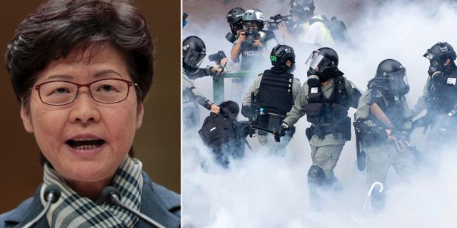 Carrie Lam och polis som griper en demonstrant i tårgasröken i Hongkong.  TT/AP