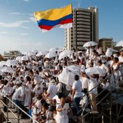 People wait for the start of the peace ceremony prior the signing of a peace agreement between Colombia?Äôs government and the Revolutionary Armed Forces of Colombia, FARC, in Cartagena, Colombia, Monday, Sept. 26, 2016. Colombia's government and the FARC will sign a peace agreement to end over 50 years of conflict. Fernando Vergara / TT NYHETSBYRÅN