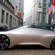Chinese electric vehicle start-up NIO Inc. vehicle is parked in front of the New York Stock Exchange (NYSE) to celebrate the company's initial public offering (IPO) in New York, U.S., September 12, 2018. Brendan McDermid / TT NYHETSBYRÅN