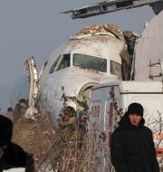 Flygplanet på olyckplatsen.  PAVEL MIKHEYEV / TT NYHETSBYRÅN