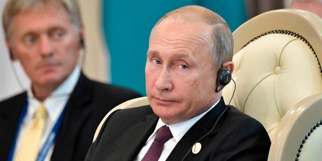 Dmitrij Peskov och Vladimir Putin. Alexei Nikolsky / TT NYHETSBYRÅN/ NTB Scanpix