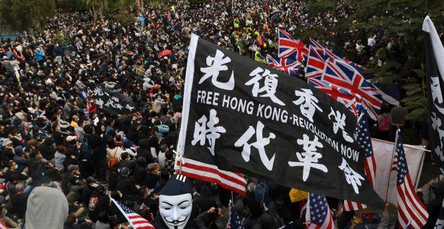 Bild från Hongkong.  Ng Han Guan / TT NYHETSBYRÅN