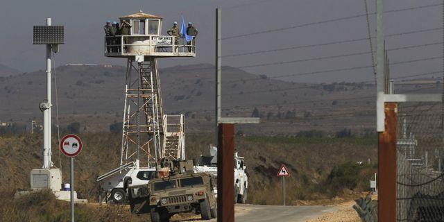 Ett utkikstorn vid gränsen mellan Syrien och Israel.  JALAA MAREY / AFP