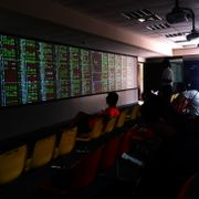 Kaohsiung, Taiwan - August 29, 2019: Investors in the seat to monitor the stock exchange rate to grasp the status quo Shutterstock