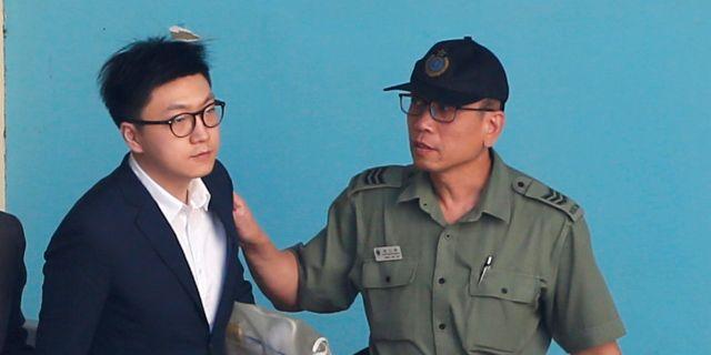 Edward Leung på väg till domstolen i Hongkong. BOBBY YIP / TT NYHETSBYRÅN