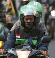 Arkivbild: Grab-chaufförer i Jakarta, Indonesien.  Achmad Ibrahim / TT NYHETSBYRÅN/ NTB Scanpix