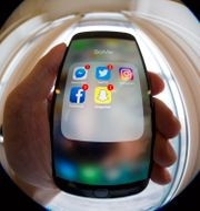 En mobiltelefon med appar.  Larsen, Håkon Mosvold / TT NYHETSBYRÅN