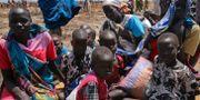 Familj i Sydsudan. Arkivbild. George Fominyen / TT / NTB Scanpix