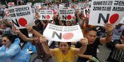 Prostester i Sydkorea mot Japans handelsrestriktioner.  TT.