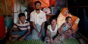 Familj som flytt Myanmar. Dar Yasin / TT NYHETSBYRÅN
