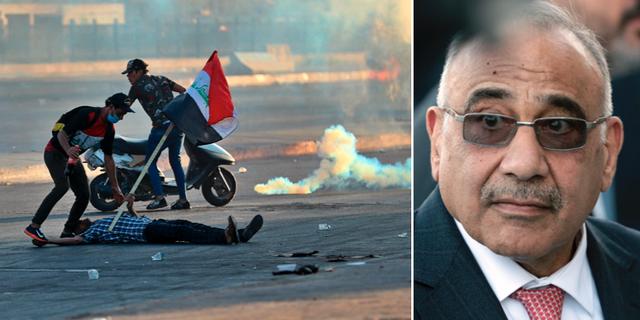 En skadad demonstrant håller upp en irakisk flagga under protesterna/premiärminister Adel Abdul Mahdi. TT