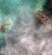 Satellitbild av det tudelade fartyget. TT NYHETSBYRÅN