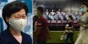 Carrie Lam/Människor i munskydd i Hongkong.  TT