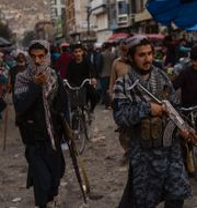 Talibaner patrullerar gatorna i Afghanistan. TT.