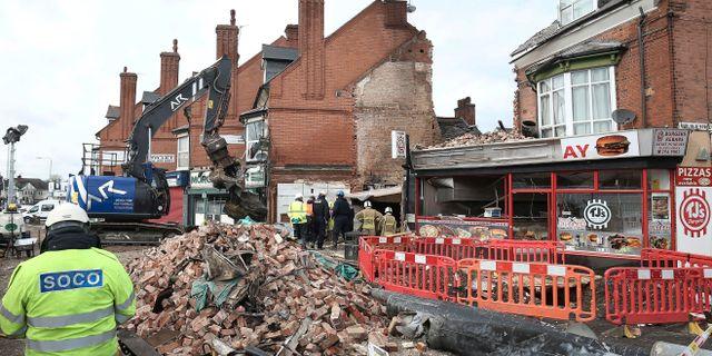 Byggnaden rasade samman efter explosionen.  Aaron Chown / TT NYHETSBYRÅN