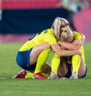 Besvikna svenska spelare.  DANIEL STILLER / BILDBYRÅN
