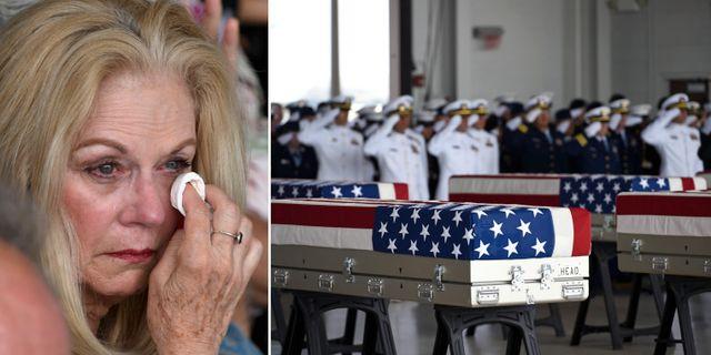 En kvinna gråter vid ceremin i Hawaii/Kistorna med kvarlevorna.  TT