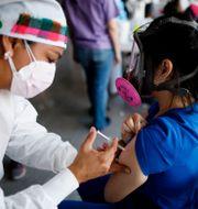 Covidvaccinering i Honduras. Arkivbild. Elmer Martinez / TT NYHETSBYRÅN